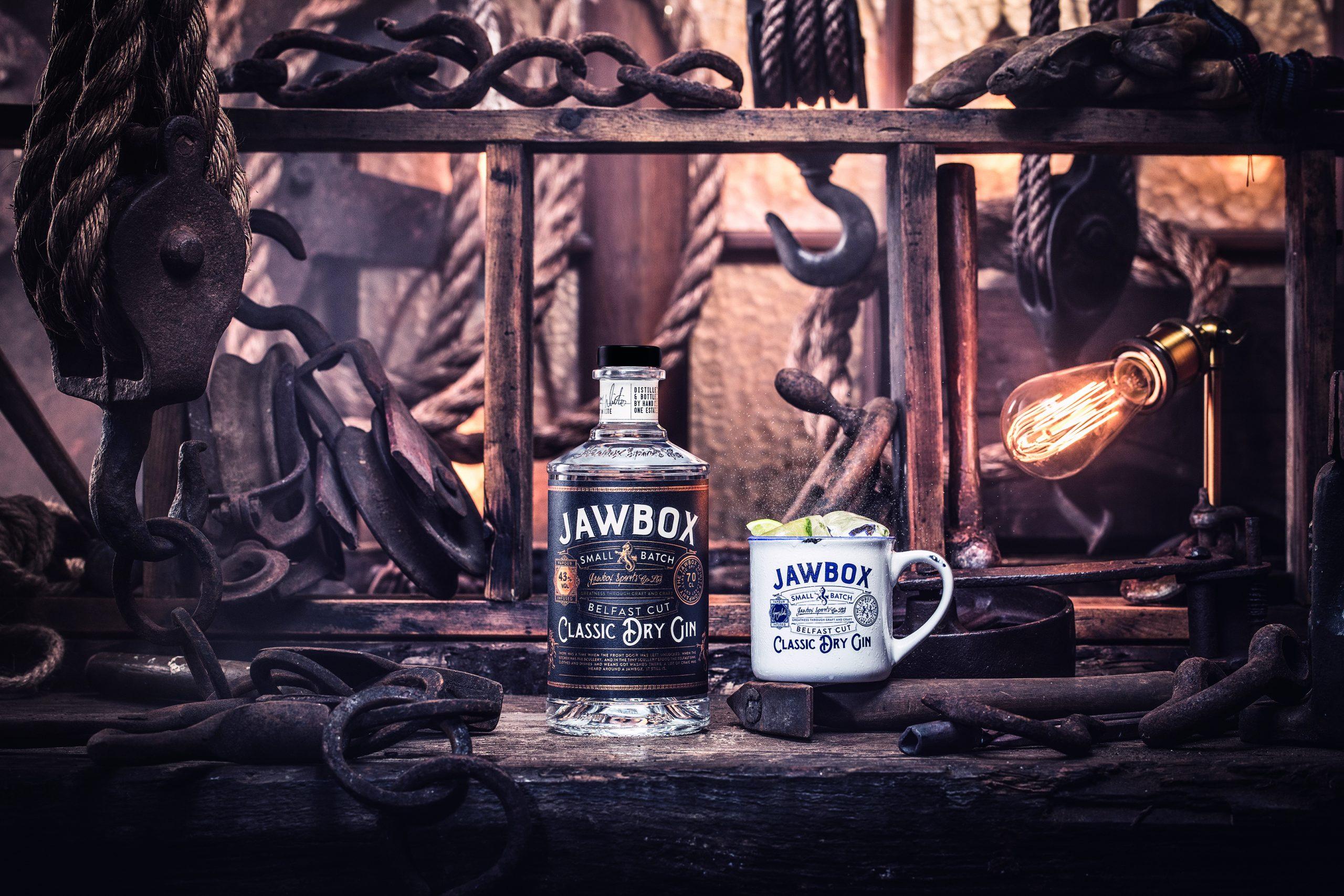 Jawbox Gin bottle and mug in warehouse setting