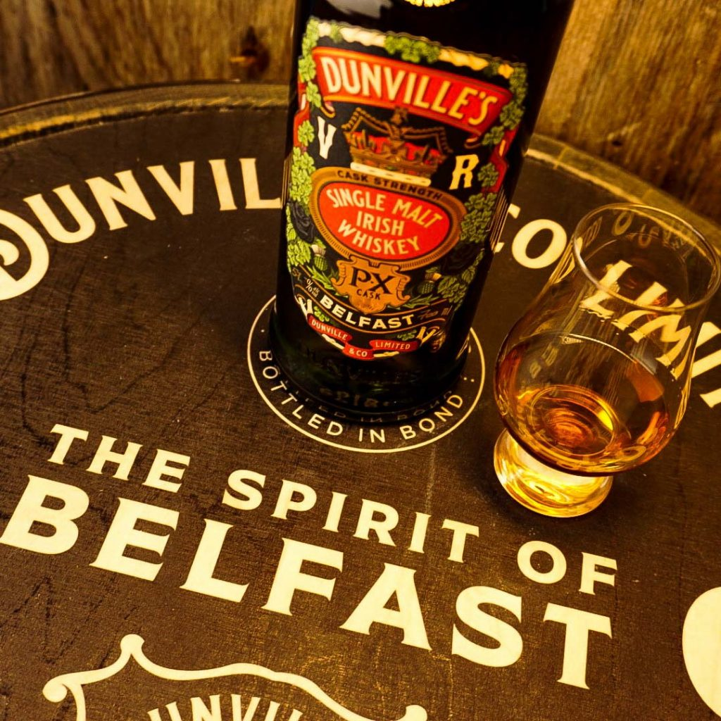 Dunville's PX Cask Strength bottle and glass with Spirit of Belfast message
